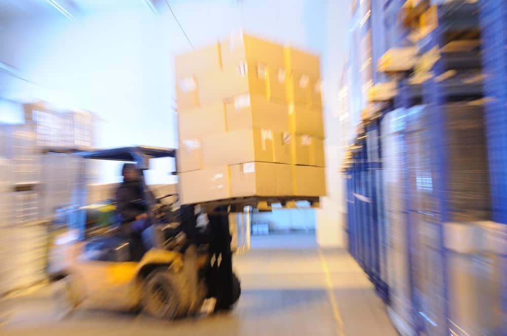 forklift loading a pallet rack